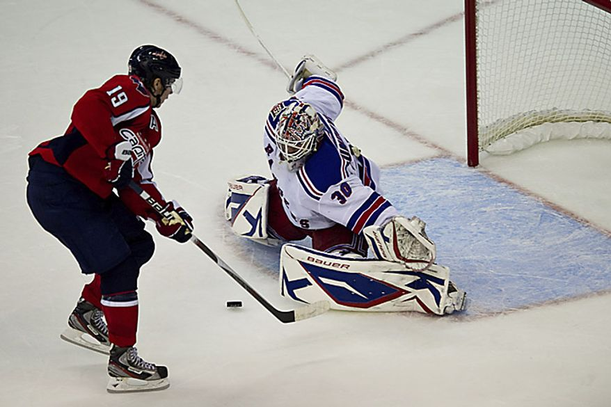 Rangers goalie Henrik Lundqvist stops a shot by Capitals center Niklas Backstrom during the second period of a playoff game at the Verizon Center in Washington on Wednesday, April 13, 2011. (Drew Angerer/The Washington Times)
