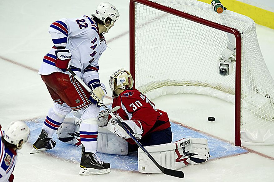 Rangers center Brian Boyle gets the puck past Capitals goalie Michal Neuvirth for a goal to put the Rangers up 1-0 during the third period of a playoff game at the Verizon Center in Washington on Wednesday, April 13, 2011. (Drew Angerer/The Washington Times)
