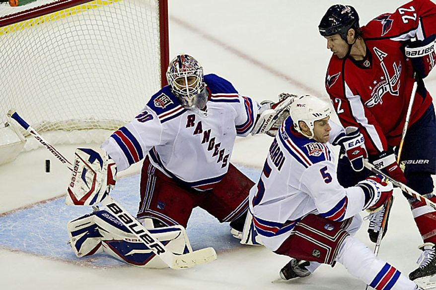Rangers goalie Henrik Lundqvist reaches out to stop the puck during the third period of a playoff game against the Capitals at the Verizon Center in Washington on Wednesday, April 13, 2011. (Drew Angerer/The Washington Times)