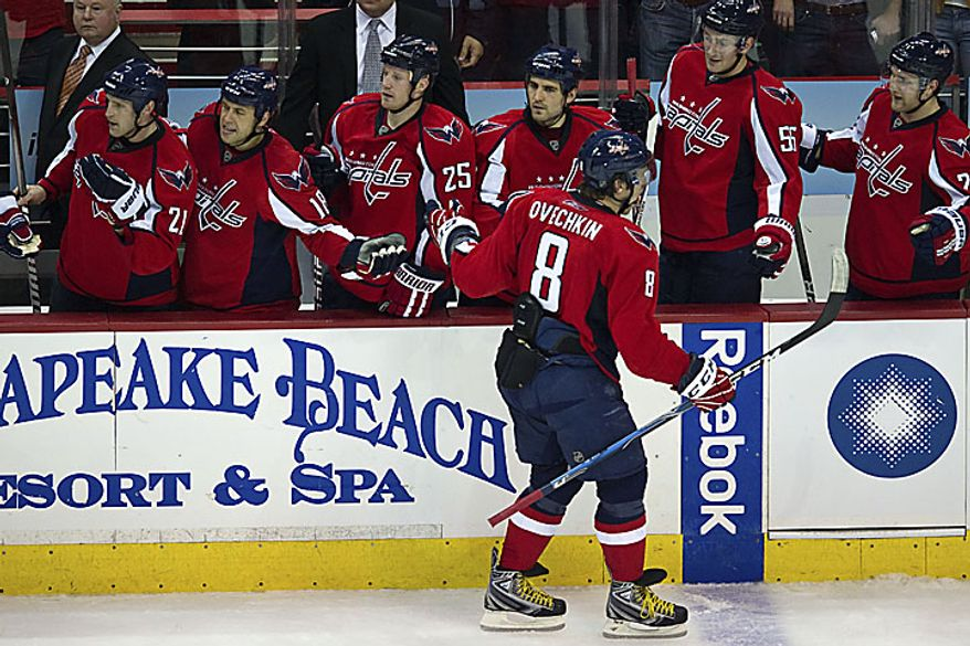 Alex Ovechkin gives high fives to teammates after tying the game 1-1 during the third period of a playoff match against the New York Rangers at the Verizon Center in Washington on Wednesday, April 13, 2011. (Drew Angerer/The Washington Times)