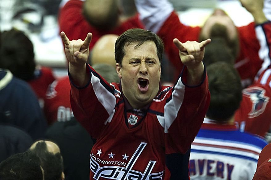 A Capitals fan celebrates after Alex Ovechkin tied the game at 1-1 during the third period of a playoff match against the New York Rangers at the Verizon Center in Washington on Wednesday, April 13, 2011. (Drew Angerer/The Washington Times)