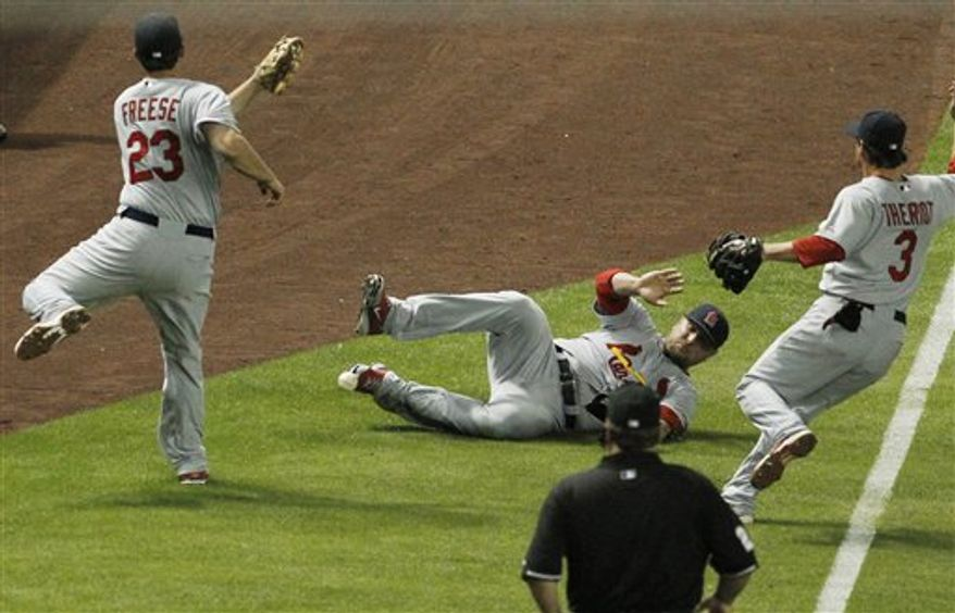 Arizona Diamondbacks' Gerardo Parra is unable to make the catch on a foul ball hit by St. Louis Cardinals' Skip Schumaker in the fourth inning of an MLB baseball game on Wednesday, April 13, 2011, in Phoenix. (AP Photo/Ross D. Franklin)