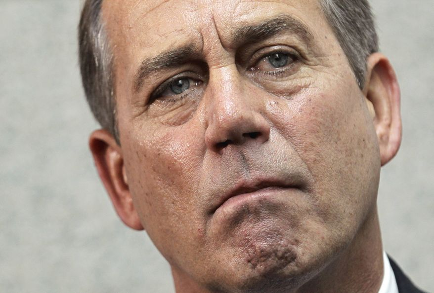House Speaker John Boehner of Ohio, speaks to reporters on Capitol Hill in Washington, Wednesday, April 13, 2011, about President Barack Obama's speech on the deficit and his plan for future spending. (AP Photo/J. Scott Applewhite)