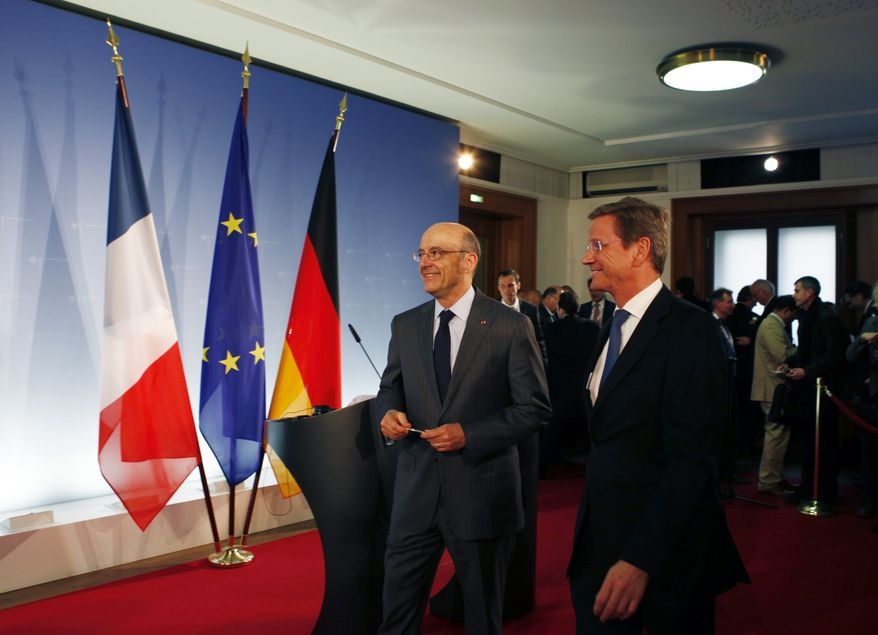 French Foreign Minister Alain Juppe (left) and German Foreign Minister Guido Westerwelle leave after a bilateral conference before an informal meeting of NATO foreign ministers at the Foreign Ministry in Berlin on Thursday, April 14, 2011. (AP Photo/Markus Schreib