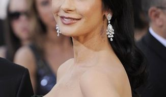 Actress Catherine Zeta-Jones arrives at the Golden Globe Awards in Beverly Hills, Calif., on Jan. 16, 2011. (AP Photo/Chris Pizzello, file)