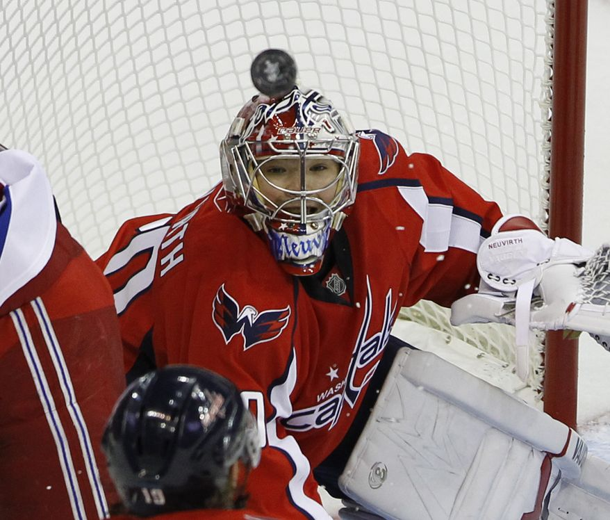 Washington Capitals goalie Michal Neuvirth, from the Czech Republic, keeps his eye on the puck in the second period of Game 1 of a first-round NHL hockey playoff series with the New York Rangers, Wednesday, April 13, 2011, in Washington.(AP Photo/Alex Brandon)