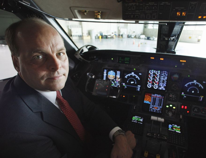 """** FILE ** In this Sept. 18, 2008, file photo, Federal Aviation Administration (FAA) Chief Operating Officer Hank Krakowski poses in the cockpit of an FAA jet in a hangar at Washington's Reagan National Airport. Krakowski, the official who oversees the nation's air traffic system resigned Thursday and the FAA began a """"top to bottom"""" review of the entire system following disclosures of four instances of air traffic controllers sleeping on the job. (AP Photo/Charles Dharapak, File)"""