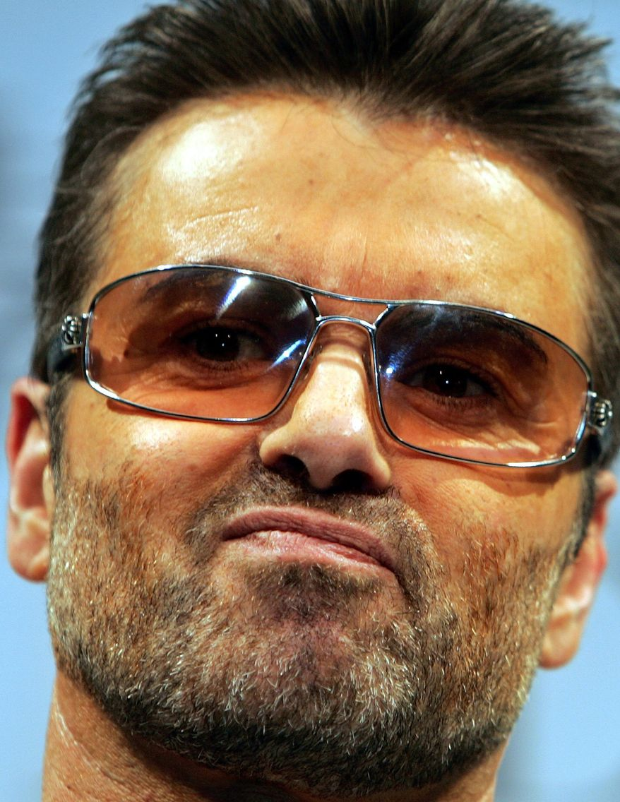 """** FILE ** In this Dec. 15, 2005, file photo, British singer George Michael poses for a photo session prior to a press conference to promote his documentary film """"George Michael: A different story,"""" at a hotel in Tokyo. George Michael isn't invited to the royal wedding, but he has recorded a song for Prince William and Kate Middleton. (AP Photo/Junji Kurokawa, File)"""