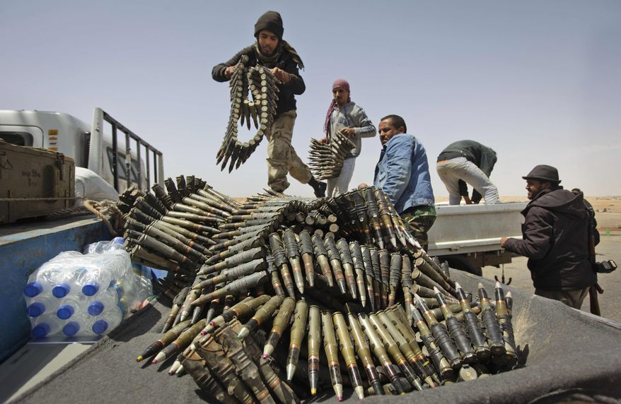 Libyan rebel fighters load a truck with ammunition on the outskirts of Ajdabiya, Libya, Saturday, April 16, 2011. (AP Photo/Ben Curtis)