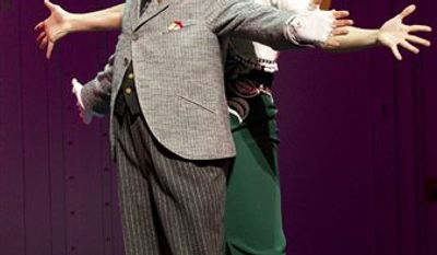 """In this theater publicity image released by Boneau/Bryan-Brown, Joel Grey, left, and Sutton Foster are shown from the musical """"Anything Goes"""" performing at the Stephen Sondheim Theatre in New York. (AP Photo/Boneau/Bryan-Brown, Joan Marcus)"""