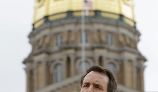 "Associated Press Former Minnesota Gov. Tim Pawlenty speaks at a tea party rally Saturday at the Statehouse in Des Moines, Iowa. ""I think one of our basic messages is, the government's too damn big,"" the Republican presidential hopeful said."