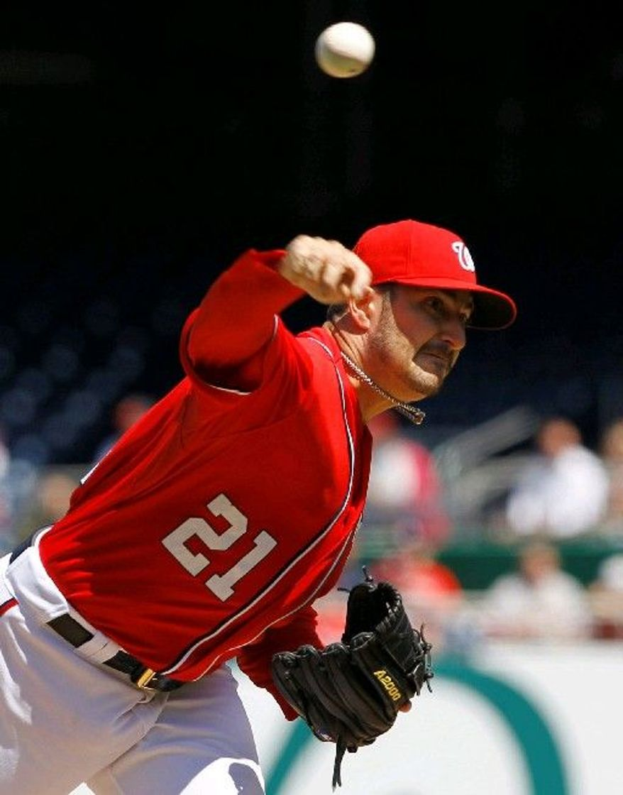 ASSOCIATED PRESS Washington Nationals pitcher Jason Marquis is trusting his defense by putting the ball over the plate more these days. It worked in the first game of Sunday's doubleheader, 8-4.