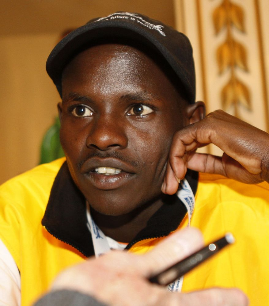 Robert Kiprono Cheruiyot of Kenya, winner of men's elite division of the 2010 Boston Marathon, listens to reporter's question during a news conference for the 115th Boston Marathon, Friday, April 15, 2011, in Boston. The Boston Marathon is schedulted to run on Monday, April 18. (AP Photo/Bizuayehu Tesfaye)