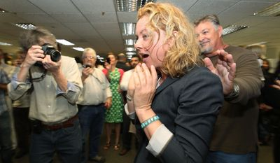 Los Angeles Times photographer Barbara Davidson learns Monday that she won the 2011 Pulitzer Prize for feature photography for a series on gang violence in the city. The Times also won a Pulitzer for exposing high salaries in Bell, Calif. (Associated Press)