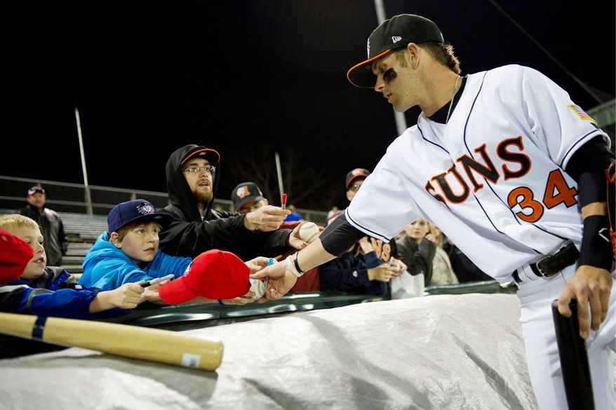 DREW ANGERER/THE WASHINGTON TIMES Nationals prospect Bryce Harper, the first overall pick in last year's draft, obliges autograph seekers at the Class A Hagerstown Suns' home opener Friday. Harper's season is off to a 9-for-39 start with 12 strikeouts in 12 games.