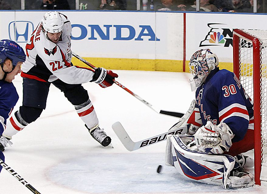 Washington Capitals right wing Mike Knuble (22) scores against New York Rangers goalies Henrik Lundqvist (30) in the third period of Game 3 of their first-round NHL Stanley Cup playoff series at Madison Square Garden in New York, Sunday, April 17, 2011. The Rangers defeated the Capitals 3-2. (AP Photo/Kathy Willens)