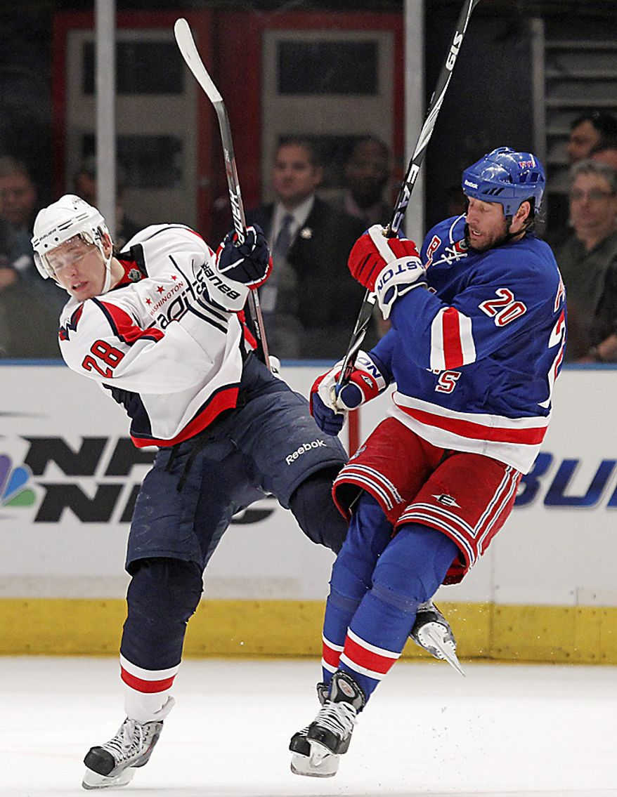 Washington Capitals left wing Alexander Semin (28) checks New York Rangers center Vaclav Prospal (20) in the second period of Game 3 of  their first-round NHL Stanley Cup playoff series at Madison Square Garden in New York, Sunday, April 17, 2011. The Rangers defeated the Captials 3-2. (AP Photo/Kathy Willens)