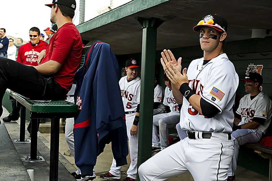 Bryce Harper waits in the dugout before taking the field for the Hagerstown Suns' home opener against the Lakewood Blueclaws at Municipal Stadium in Hagerstown, Md., on Friday, April 15, 2011. (Drew Angerer/The Washington Times)