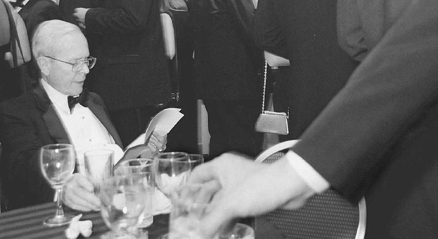 **FILE** William Rusher attends the American Conservative Union's Conservative Century dinner at the Washington Hilton in 1999. (The Washington Times)