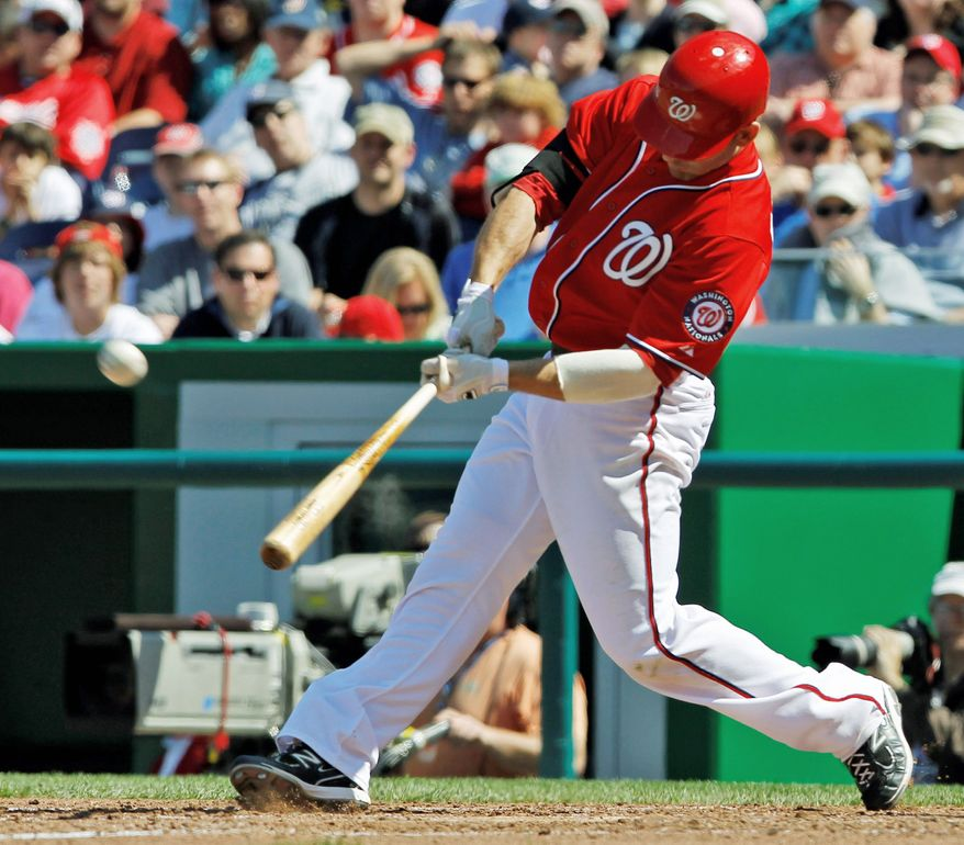Nationals second baseman Danny Espinosa connected for a three-run home run in the first game of a doubleheader against Milwaukee on Sunday. He added a bases-clearing triple in the nightcap, and both hits came batting left-handed. (Associated Press)