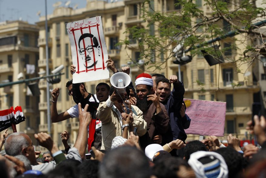 Egyptians chant slogans as they protest the government in Tahrir Square in Cairo on Friday, April 15, 2011. (AP Photo/Khalil Hamra)