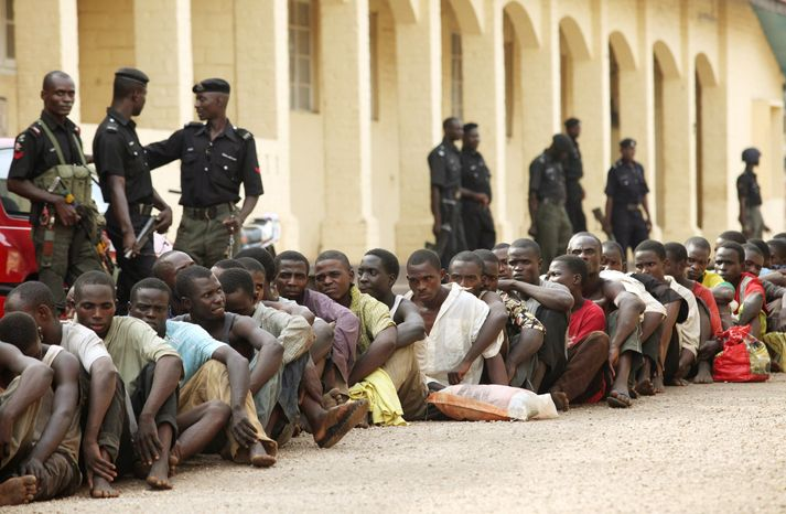 Suspected rioters await a court hearing in Kaduna, Nigeria. About 200 people were arraigned Wednesday in the local court for taking part in the rioting, arson and killing that followed the announcement that President Goodluck Jonathan had been re-elected. (Associated Press)