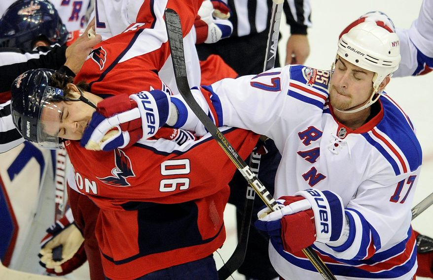 Capitals center Marcus Johansson was on the receiving end of a glove to the face from New York Rangers left wing Brandon Dubinsky during Game 2. In a physical series, Washington needs to meet push with shove. (Associated Press)