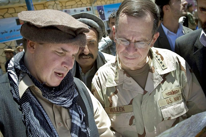 """Three Cups of Tea"" co-author Greg Mortenson in 2009 shows the locations of future village schools to U.S. Navy Adm. Mike Mullen, chairman of the Joint Chiefs of Staff, at the opening of Pushghar Village Girls School in Afghanistan. (Defense Department via Associated Press)"