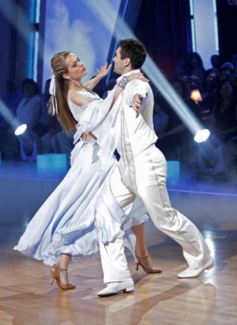 "Model Petra Nemcova and her partner, Dmitry Chaplin, were eliminated from ABC's ""Dancing With the Stars"" on Tuesday. The show inspired Miss Nemcova to start holding dance-a-thons as fundraisers for her charity, the Happy Hearts Fund. (Associated Press)"