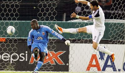 DC United goalkeeper Bill Hamid, left, kicks the ball as Los Angeles Galaxy's Juan Pablo Angel (9) defends during the second half of an MLS soccer game, on Saturday, April 9, 2011, in Washington. The game ended in a 1-1 tie. (AP Photo/Luis M. Alvarez)