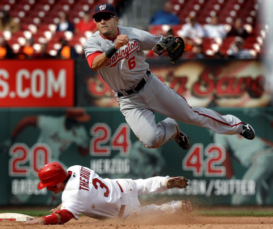 St. Louis' Ryan Theriot is out at second as Washington shortstop Ian Desmond turns a double play during the eighth inning of the first game of their doubleheader.