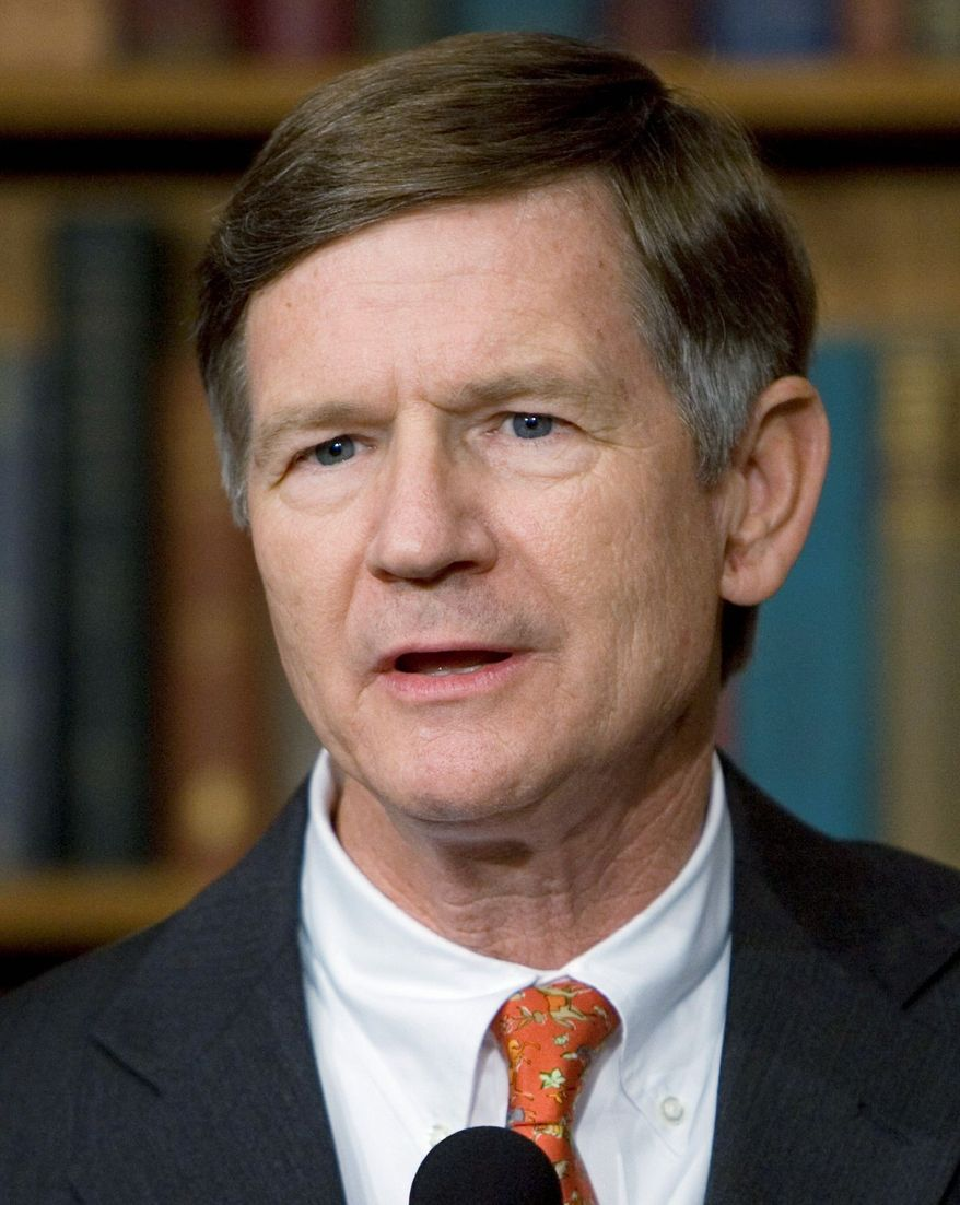 "Rep. Lamar Smith, Texas Republican, wants the Justice Department to halt Utah's guest-worker program for illegal immigrants, calling it ""unconstitutional."" (Associated Press)"