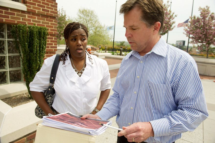 Will Foreman of Oxon Hill chats with Debra Saunders (left) of Temple Hills, Md., outside the Prince George's County Courthouse in Hyattsville on Wednesday after they both successfully beat their speeding tickets before a judge. Mr. Foreman beat his fifth speeding ticket while Ms. Saunders had her ticket thrown out. (Rod Lamkey Jr./The Washington Times)