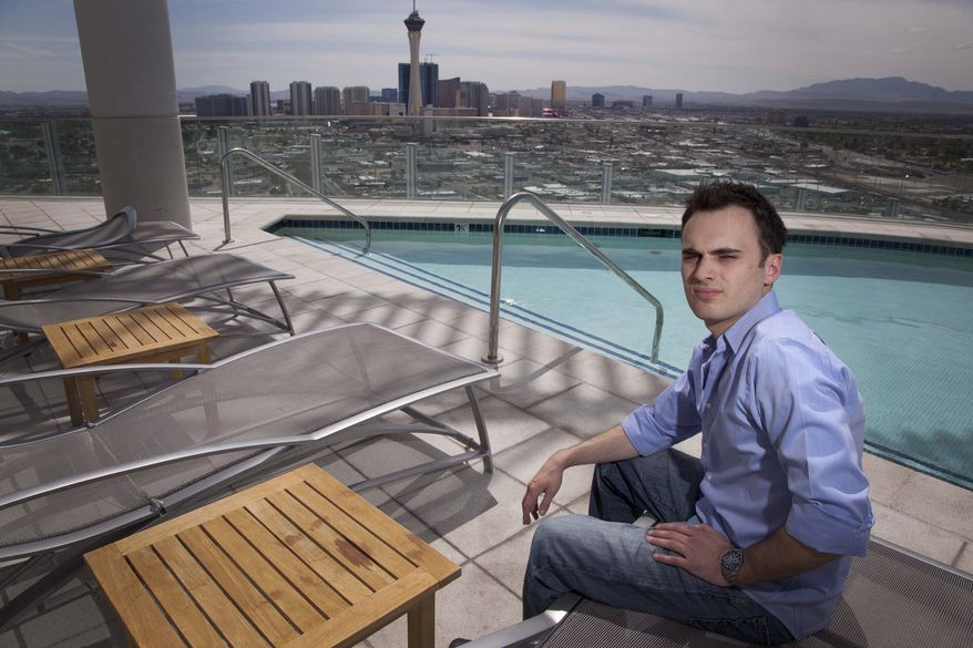 Professional online poker player Robert Fellner is seen on the roof of his Las Vegas apartment building Tuesday. Fellner, who left his job at a New Jersey dry cleaners four years ago to move to play online poker professionally, has seen his bankroll grow to $280,000. But since the government essentially shut down the poker industry with a prosecution against executives of the main companies, Fellner and others like him worry they'll never see their money again. (Associated Press)