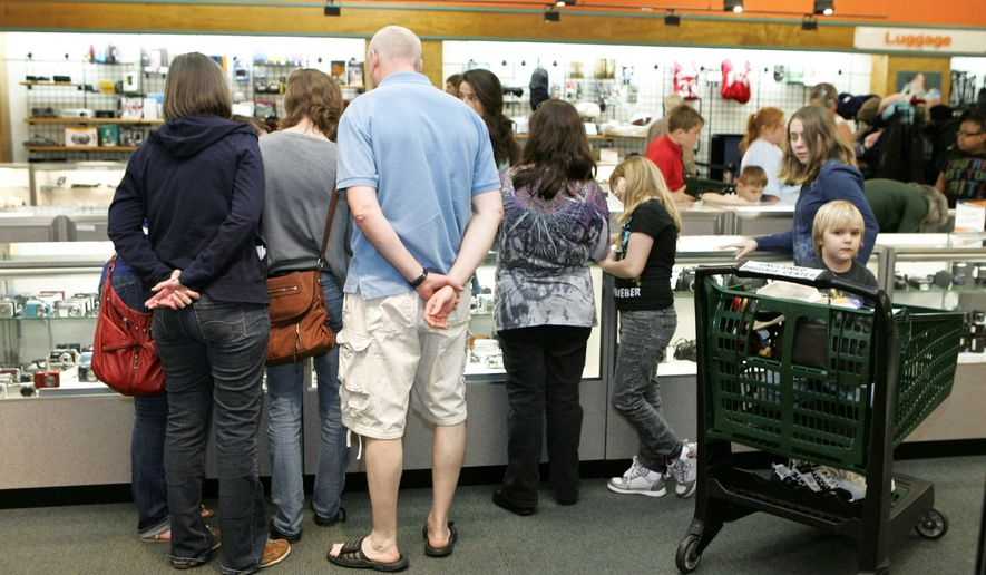 Customers peruse cameras and other electronics at the 40,000-square-foot store, which offers merchandise ranging from shoes to samurai swords at between 20 percent and 80 percent off. (Associated Press)