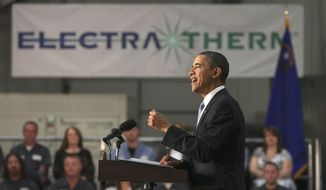 President Obama gestures while addressing the crowd during a town hall meeting at ElectraTherm, Inc. a small renewable energy company in Reno, Nev., Thursday, April 21, 2011. The President discussed reducing the national debt and bringing down the deficit. (AP Photo/Rich Pedroncelli)