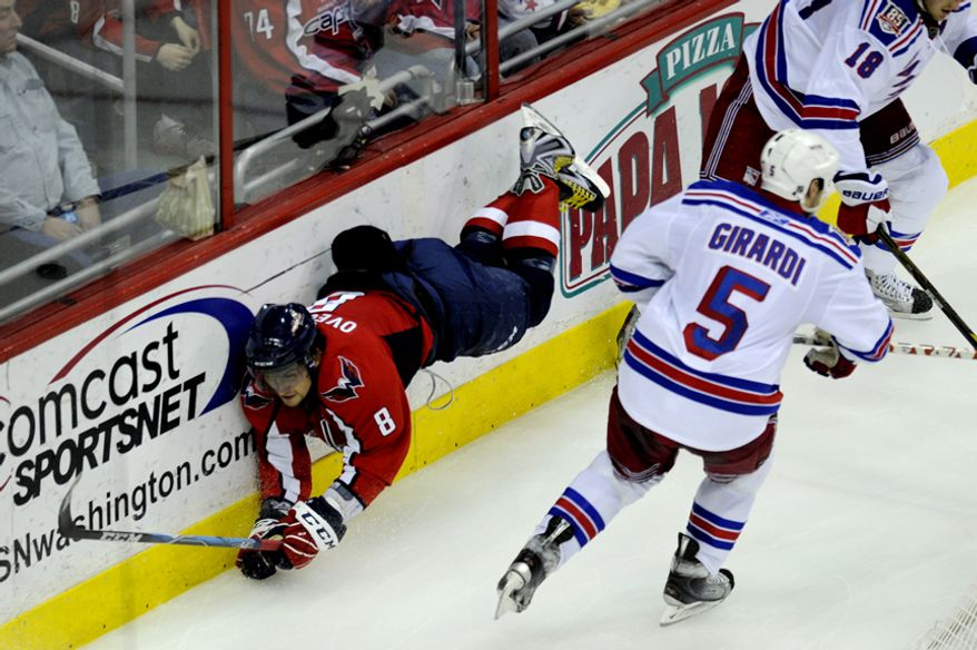 Alex Ovechkin gets tripped up in third period against the Rangers during game five of the first round playoff series, at the Verizon Center in Washington, D.C., Saturday, April 23, 2011. (Drew Angerer/The Washington Times)