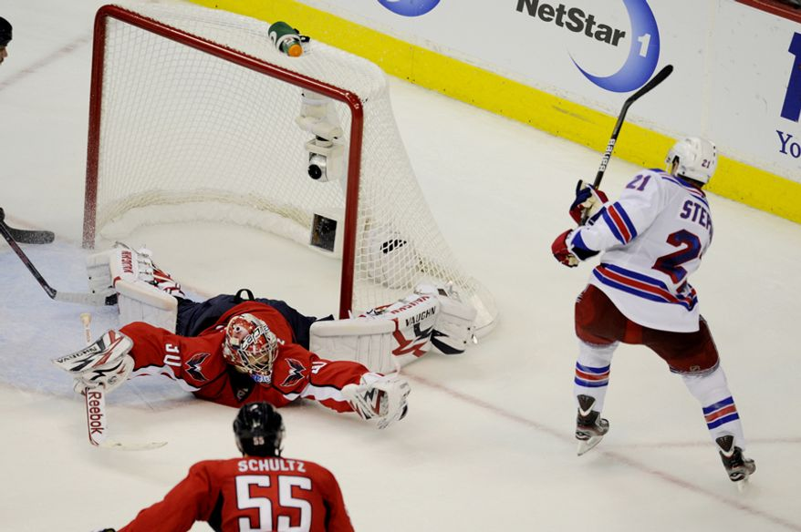 Capitals goalie Michal Neuvirth makes a stop on Rangers Derek Stephan's shot in the third period during game five of the first round playoff series, at the Verizon Center in Washington, D.C., Saturday, April 23, 2011. (Drew Angerer/The Washington Times)