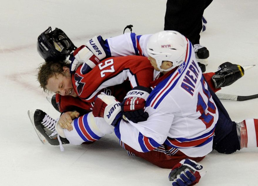 The Rangers Sean Avery and Capitals Matt Hendricks get into a fight late in the third period in game five of the first round playoff series, at the Verizon Center in Washington, D.C., Saturday, April 23, 2011. (Drew Angerer/The Washington Times)