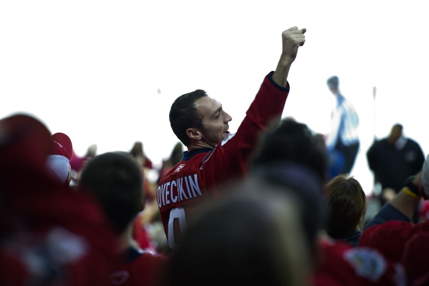Fans cheered after the Capitals won the game 3-1 over the Rangers during game five in the first round playoff series, at the Verizon Center in Washington, D.C., Saturday, April 23, 2011. (Drew Angerer/The Washington Times)