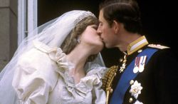 In this July 29, 1981 photo, Princess Diana and Prince Charles kiss on the balcony of Buckingham Palace on their wedding day, in London, England. (Photo: Associated Press)