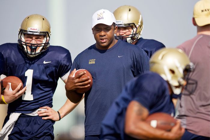 """Former Navy quarterback Ricky Dobbs (center) was a visible presence during spring practice. """"The end of the journey is only the beginning of another one,"""" he said of the end of his football career. (Drew Angerer/The Washington Times)"""