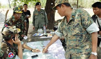 A commander of the Cambodian Royal Armed Forces gives instructions at a camp in the border disputed area in Oddar Meanchey province, Cambodia. (Associated Press)