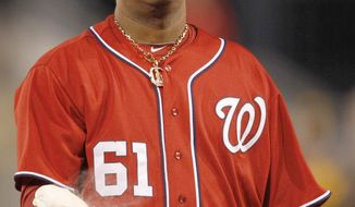 Washington Nationals starting pitcher Livan Hernandez hits the rosin bag after giving up a double to Pittsburgh Pirates' Garrett Jones that drove in a run in the Pirates 5-run first inning of the baseball game, Saturday, April 23, 2011, in Pittsburgh. (AP Photo/Keith Srakocic)