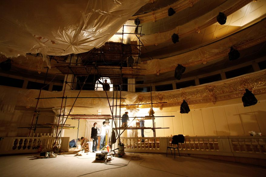 Workers restore 19th-century ornaments to the walls inside the building of the Bolshoi Theater in Moscow. Russia's iconic theater has been closed for reconstruction since 2005, spawning accusations of embezzlement and fraud. (Associated Press)