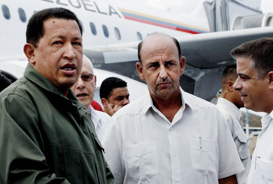 Then-Cuban Vice President Carlos Lage (second from right in photo with Venezuela's President Hugo Chavez in 2006) fell from power after he was caught on tape joking about Cuba's old leaders. He's now reportedly working as a hospital administrator. (Associated Press)