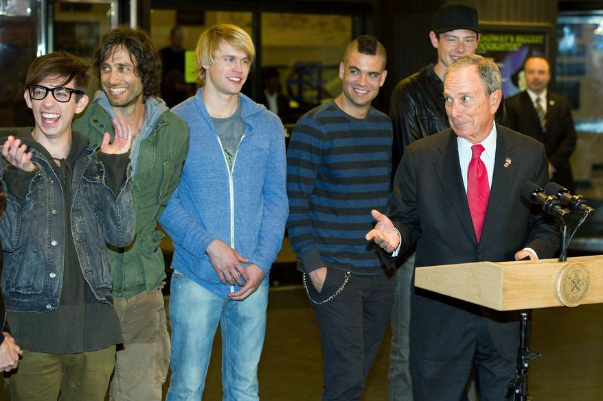 """ASSOCIATED PRESS """"It would be great to see what happens with Finn and Rachel,"""" New York City Mayor Michael Bloomberg (right) said as he met members of the cast of """"Glee"""" on Monday. The cast was in New York to film the current season's finale."""