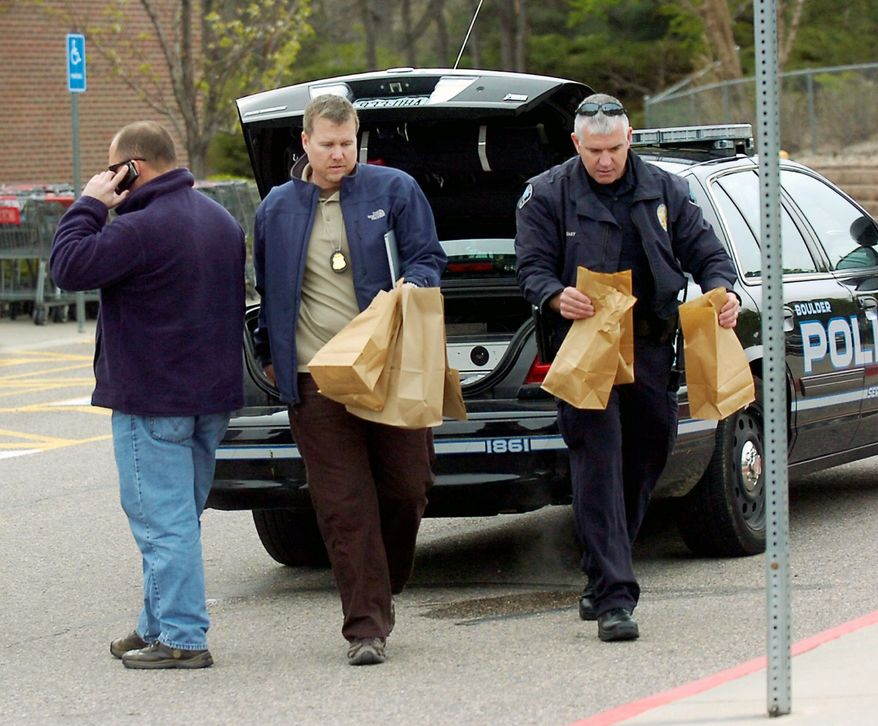 ASSOCIATED PRESS PHOTOGRAPHS Investigators collect evidence at King Soopers grocery store morning in Boulder, Colo., where a suspect in a case involving an undetonated pipe bomb and two propane tanks at a Denver-area shopping mall on April 20 was arrested.