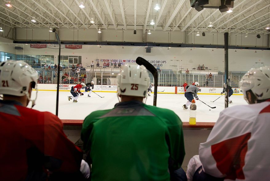 BARBARA L. SALISBURY/THE WASHINGTON TIMES The Capitals practiced Tuesday at the Kettler Capitals Iceplex in Arlington to keep their edge while waiting for their second-round opponent to be determined. Washington won its opening series against the New York Rangers in five games.