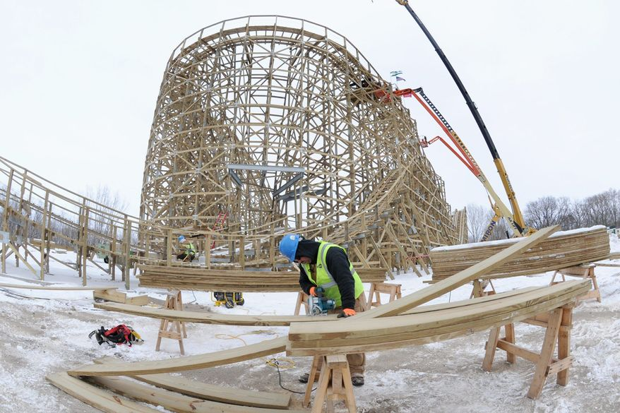 """ASSOCIATED PRESS Dan Carpenter works to get on track for a replica of the Zippin Pippin, Elvis Presley's favorite roller coaster, at Bay Beach Amusement Park in Green Bay, Wis. Mayoral candidate Patrick Evans complained early and often about the $3.5 million cost, but his campaign """"got swept up in the tidal wave"""" of the collective bargaining fight in Madison."""